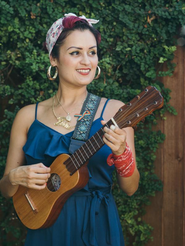 Denise Carlos of Las Cafeteras plays the <em>jarana</em>,<em> </em>a guitar-like string instrument from Mexico.