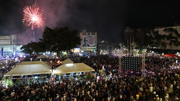 Fireworks go off as Catholic faithful watch a televised screening of the ceremony of the canonization of martyred archbishop Oscar Romero at Gerardo Barrios Square in San Salvador on Sunday.