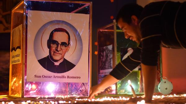 A man lights a candle in Ciudad Barrios, the hometown of blessed Monsignor Oscar Romero, some 165 kilometres from San Salvador, to mark his canonization Sunday.