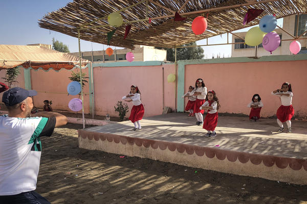 Schoolchildren are led through a dance routine at a U.S. government-supported childcare center in Raqqa.