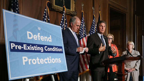 Sen. Joe Manchin, D-W.Va., speaks on a proposed protection plan for people with pre-existing health conditions at a news conference in July. The fate of Obamacare could be decided by which party wins control of Congress in November.
