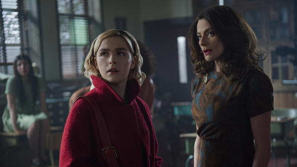 Here Comes Satan Clause: Sabrina (Kiernan Shipka) and Miss Wardwell (Michelle Gomez) literally deal with the devil in Netflix's <em>Chilling Adventures of Sabrina</em>.