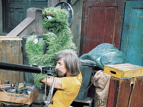 Spinney with Oscar the Grouch on the set of <em>Sesame Street</em>.
