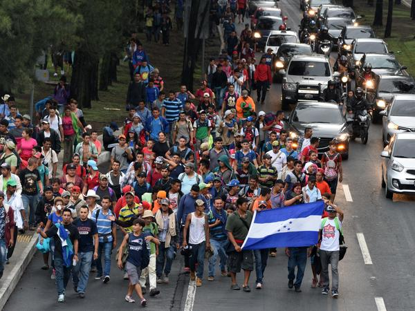 Honduran migrants walk toward Tecún Umán, a Guatemalan town along the Mexican border, as they leave Guatemala City on Thursday.
