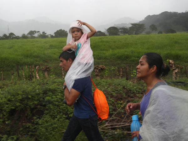 People in a migrant caravan make their way towards the border with Mexico on Thursday in Siquinalá, Guatemala.