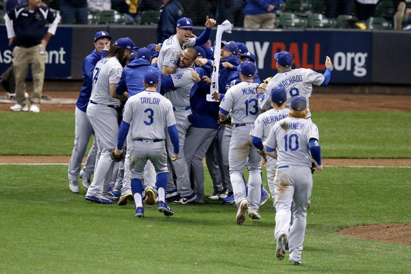The Los Angeles Dodgers celebrate after defeating the Milwaukee Brewers in Game 7 to win the National League Championship Series at Miller Park on Saturday, in Milwaukee.