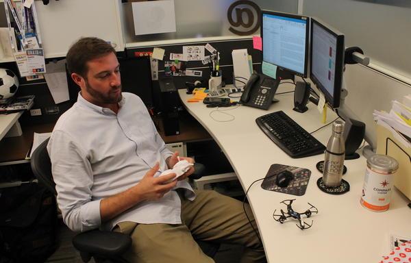 Justin Winn playing with his mini drone.