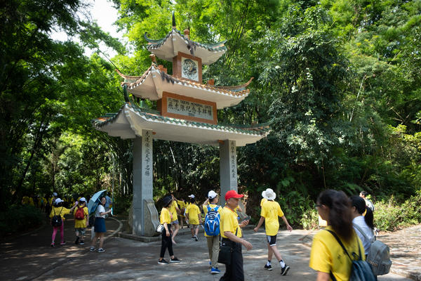 Students on the trip visit a memorial to Chinese-American volunteers, who fought the Japanese in China with the Flying Tigers unit during World War II.