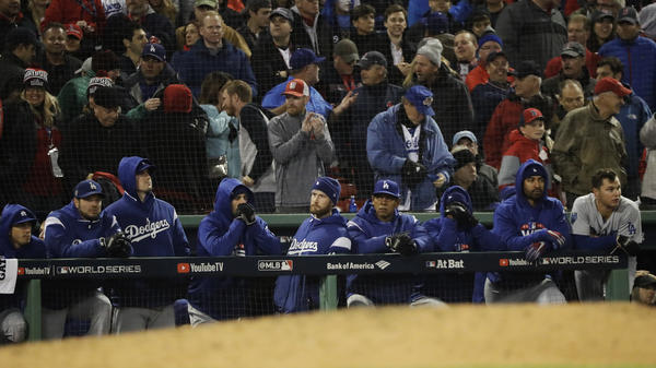 Los Angeles Dodgers watch the ninth inning of Game 1 of the World Series on Tuesday night at Fenway Park in Boston. The Red Sox defeated the Dodgers 8-4 to take the lead in the series.