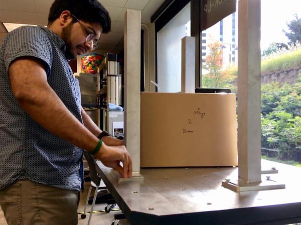 Designers at BillerudKorsnäs use a shaking machine to mimic the bumps on a delivery truck. It's one of several tests that tell them whether their paper packaging is strong enough to replace plastic.