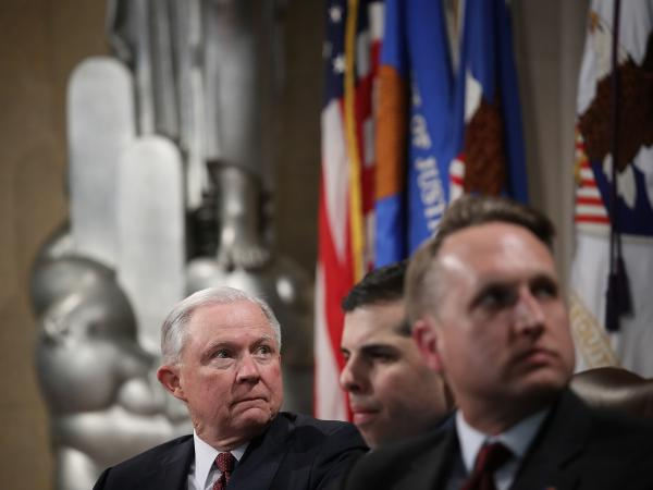 U.S. Attorney General Jeff Sessions (left) and Acting Assistant Attorney General John Gore (right) attend an April event at the Justice Department in Washington, D.C. Gore reportedly has testified that Sessions directed the DOJ not to discuss alternatives to the 2020 census citizenship question with the Census Bureau.