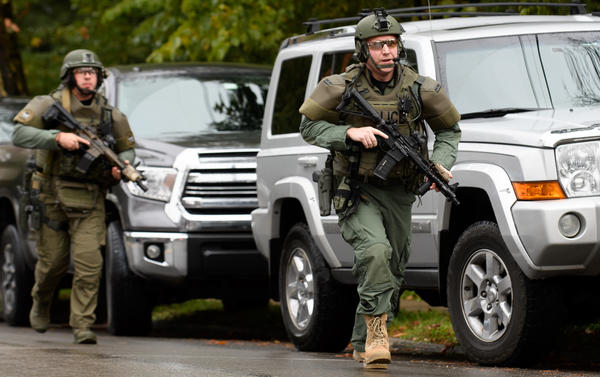 Police rapid response team members respond to the site of a mass shooting at the Tree of Life Synagogue in the Squirrel Hill neighborhood.