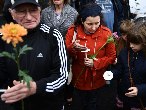 People pay their respects outside the Tree of Life synagogue in Pittsburgh. The 11 people who were killed on Saturday ranged in age from 54 to 97.