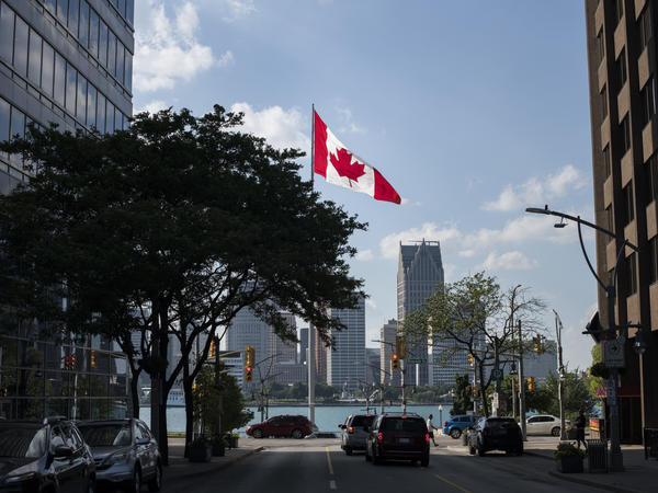 Canada legalized recreational marijuana in this month, but Canadians can find themselves barred from entering the U.S. if they say they've used it. A Canadian flag flies in Windsor, Ontario, in June, with the Detroit skyline visible behind it.