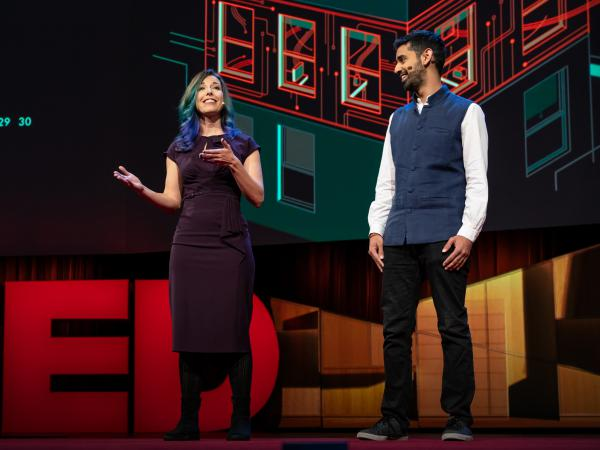 Kashmir Hill and Surya Mattu on the TED stage.