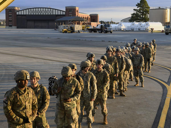 Soldiers from the 541st Sapper Company headed to the southern U.S. border prepare to board an air transport plane on Tuesday in Ft. Knox, Ky.
