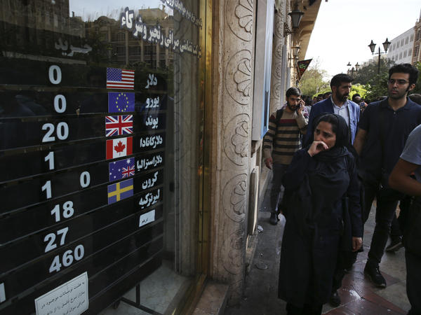 An exchange shop displays rates for various currencies in downtown Tehran last month. Iran is bracing for the restoration of U.S. sanctions on its vital oil industry set to take effect on Monday, as it grapples with an economic crisis that has sparked sporadic protests over rising prices, corruption and unemployment.