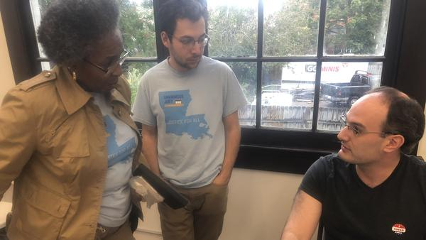 Peter Robbins-Brown (right) is  coordinating the teams of canvassers about to head out door-to-door to educate voters about the unanimous jury constitutional amendment. Janice Long (left) will be canvass with Elias Newman (center).
