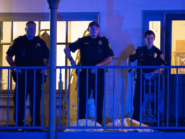 Police officers are stationed outside the Hot Yoga Tallahassee studio after a gunman killed two people and injured several others Friday evening.