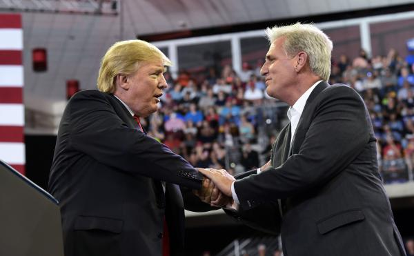 President Trump shakes hands with House Majority Leader Kevin McCarthy during a rally this summer. If Republicans keep their majority, McCarthy could be the next speaker of the House.
