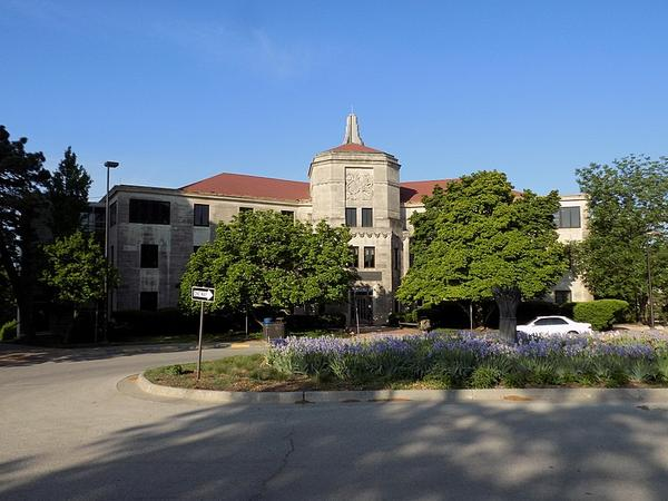 The University of Kansas School of Social Work. Then-KU social work professor Michelle Johnson Motoyama and current KU economist Donna Ginther received a grant to research the effects of safety net policies on child welfare.