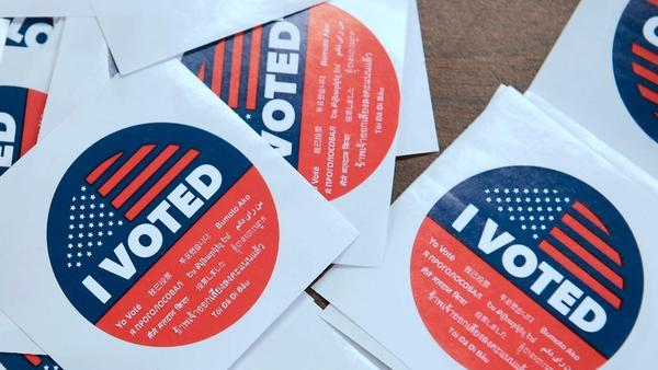 "California's multilanguage ""I Voted"" stickers on offer for early voters at the Los Angeles County Registrar's Office in Norwalk, Calif."