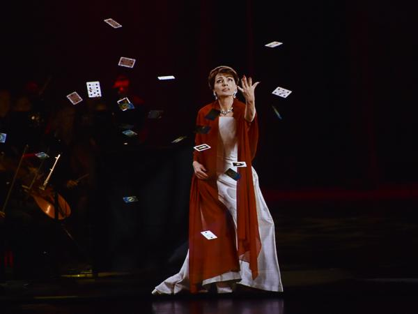 Maria Callas, the hologram, tosses cards, which hover, momentarily, in mid-air, in the production <em>Callas in Concert</em>.