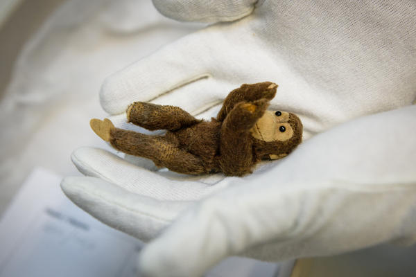 Gert Berliner packed this toy monkey in a suitcase when he fled for his life nearly 80 years ago. It's now part of the collection at the Jewish Museum Berlin.