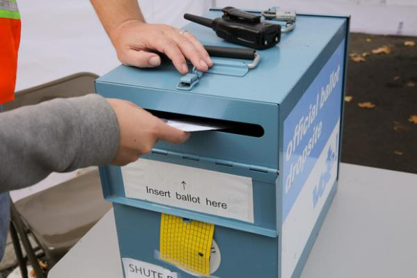 <p>A ballot is dropped off at the Washington County Elections Office in Beaverton, Ore. on Nov. 5, 2018.</p>
