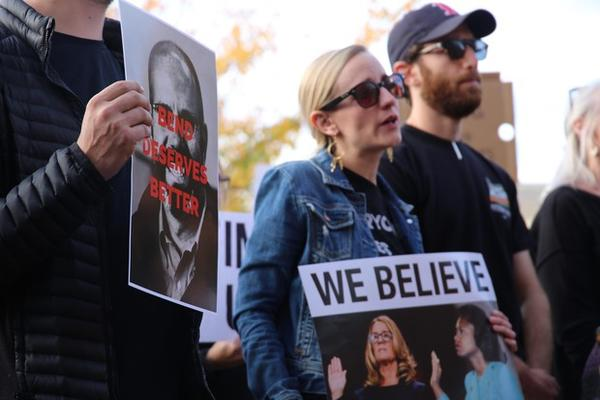 """<p>Protestors outside Bend City Hall on Oct. 3 carried pictures of Nathan Boddie's face with the text """"Bend Deserves Better.""""</p>"""
