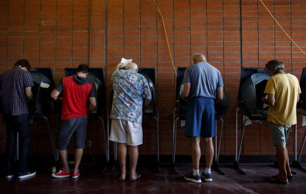 Voters cast ballots at a polling station in Newport Beach, Calif., on Tuesday.