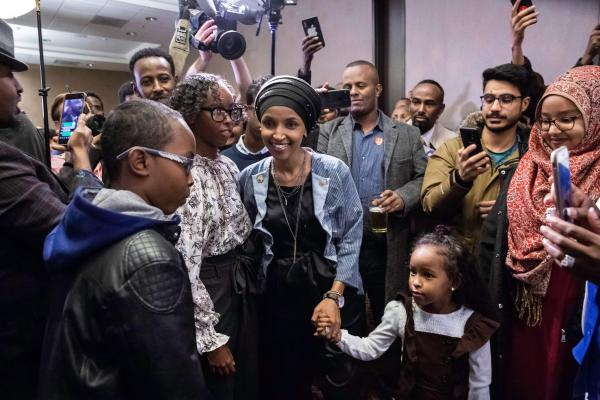 Democrat Ilhan Omar (center), newly elected to the House of Representatives, arrives for her victory party in Minneapolis on Tuesday. Voters elected two Muslim women, both Democrats, to Congress, marking a historic first.