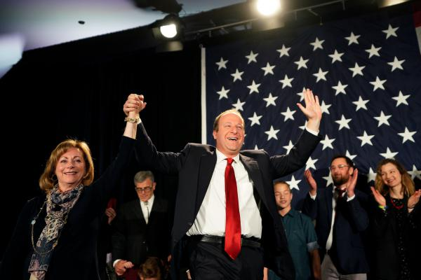 Jared Polis arrives onstage with running mate Dianne Primavera in Colorado. Polis defeated Walker Stapleton to become the first openly gay man elected governor in the U.S.