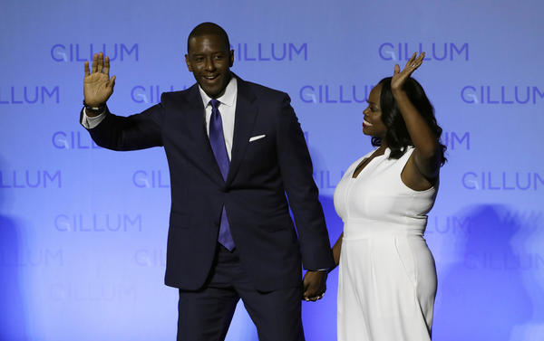 Florida Democratic gubernatorial candidate Andrew Gillum and his wife R. Jai Gillum wave to supporters before delivering his conesssion speech Tuesday, Nov. 6, 2018, in Tallahassee, Fla.