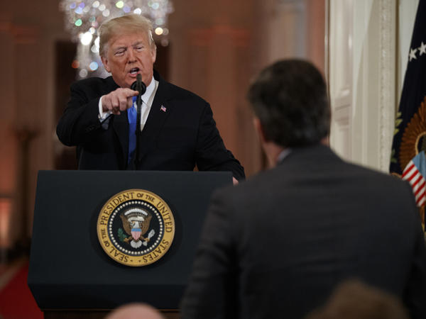 President Donald Trump speaks to CNN journalist Jim Acosta during a news conference in the East Room of the White House in Washington.