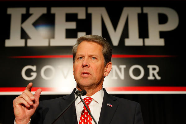 Republican gubernatorial candidate Brian Kemp has declared victory in a closely-fought race with Democrat Stacey Abrams that included accusations he abused his office to win the election.