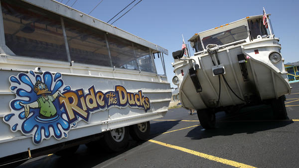 Duck boats sit idle in the parking lot of Ride the Ducks days after the accident in July in Branson, Mo. Kenneth Scott McKee, the captain and operator of a boat that sank on July 19, was charged on Thursday with criminal misconduct and negligence resulting in 17 deaths on Table Rock Lake.
