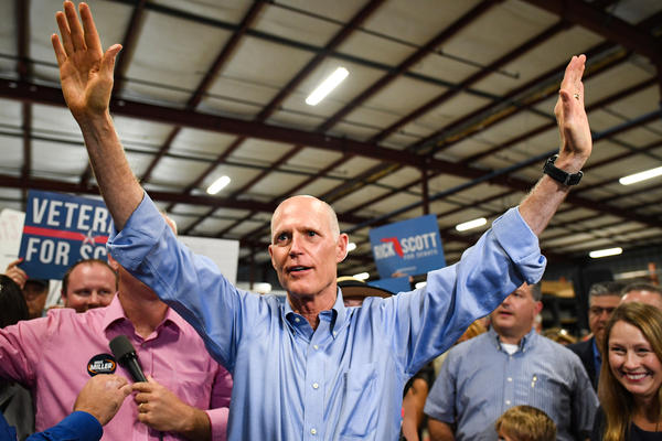 Florida Republican Senate candidate Gov. Rick Scott attends a rally at Skyline Attractions on Nov. 2 in Orlando, Fla.