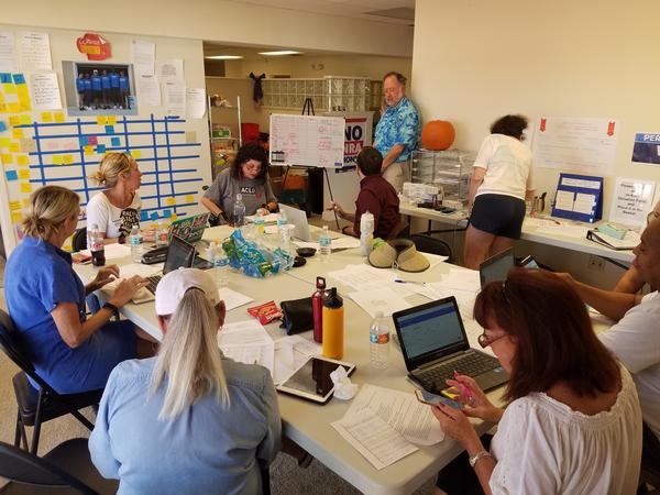 Volunteers at a former Democratic candidate David Holden's headquarters on Thursday try to connect provisional voters with their ballots.