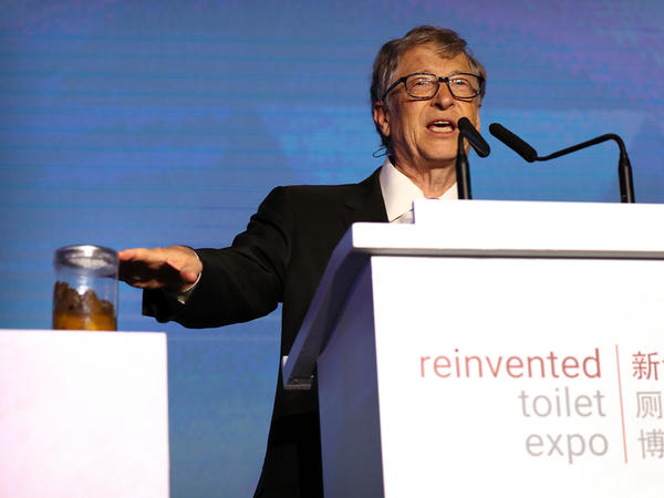 Bill Gates, co-founder of the Bill & Melinda Gates Foundation, gestures to a jar of human feces as he speaks at the Reinvented Toilet Expo in Beijing on November 6.