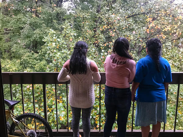 """Ericka and Angeles with their mom, at home in a Washington, D.C., suburb. It's been two years since the family was reunited, and the girls say they're starting to feel more settled. As time goes on, Ericka says, """"the hard times get left behind."""""""