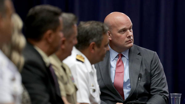Then-Department of Justice Chief of Staff Matt Whitaker, right, participates in a round table event at the Department of Justice Kennedy building August 29, 2018, in Washington, D.C.