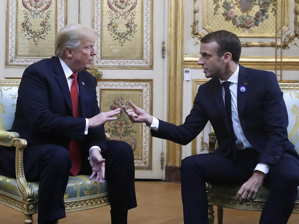 President Trump and French President Emmanuel Macron speak inside the Élysée Palace in Paris on Saturday. Trump is joining other global leaders to mark the end of World War I a century ago.