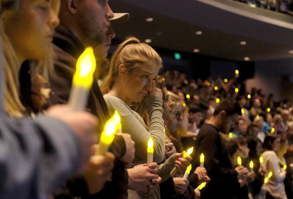 People gather to pray for the victims of a mass shooting during a candlelight vigil in Thousand Oaks, Calif., Thursday, Nov. 8, 2018. A gunman opened fire Wednesday evening inside a country music bar, killing multiple people, including a responding sheriff's sergeant.