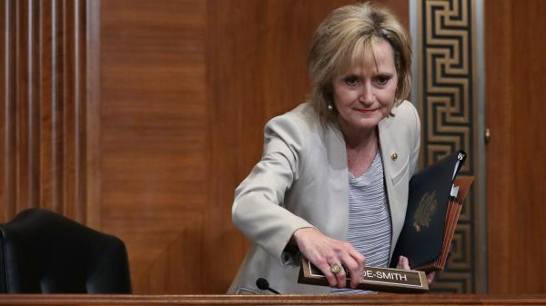 """Sen. Cindy Hyde-Smith, R-Miss., at a Senate hearing in May. She is under sharp criticism for her comments about a """"public hanging"""" in a state with a dark history of lynchings."""