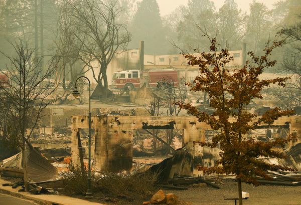 A fire truck drives through an area burned by the Camp Fire in Paradise on Tuesday.