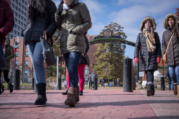 Students cross Grand Boulevard on St. Louis University's campus Tuesday.