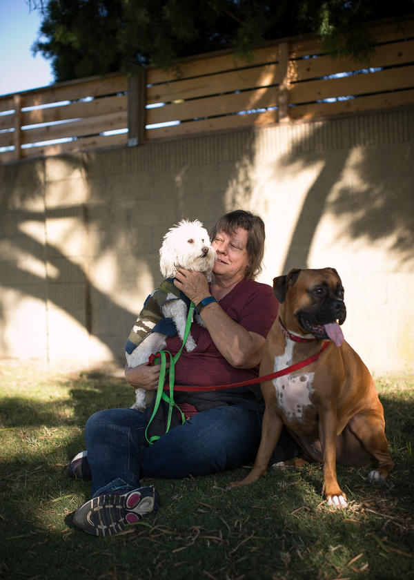 Klute-Nelson takes a break with her dogs Kona (left) and Max.