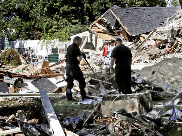 Fire investigators search the debris at a home where an explosion occurred following a gas line failure in September in Lawrence, Mass.