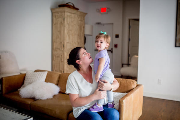 Shannon White holds her daughter, Stella. White's path to CEO was an unconventional one. She left college before getting her degree, then joined a Besh restaurant as a server, then manager.